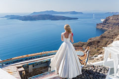 Bride  looking out to the sea Royalty Free Stock Images