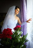 Bride looking out the window Royalty Free Stock Image