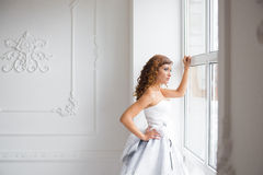Bride looking out the window, Stock Photography