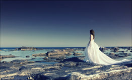 Bride looking at the sea Royalty Free Stock Photo