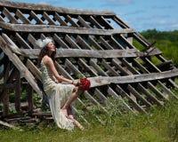 Bride looking into sky. Vintage bride looking toward sky Royalty Free Stock Photography