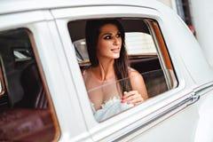 Bride looking trough car window Royalty Free Stock Photos