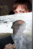 Bride looking trough window Royalty Free Stock Photos