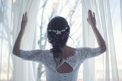 Bride looking through window Stock Images