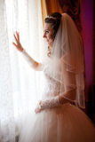 bride looking in window Royalty Free Stock Images
