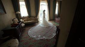 Bride Looking Through the Window in the Hotel Room stock video