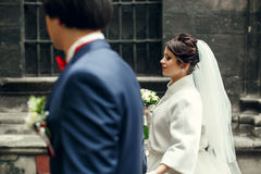 Bride looks gorgeous walking around the city with a groom Stock Image