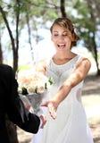 Bride looks happy to receive flowers from her groom. Portrait of beautiful bride looks happy receive flowers from her groom Stock Photo