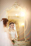 Bride looks in  mirror Royalty Free Stock Photos