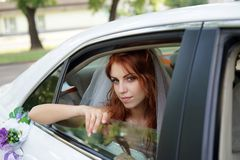 Bride. The bride looks out of a car window royalty free stock photos