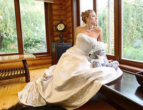 Bride looks out of the window Stock Photography