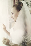 Bride looks out window Royalty Free Stock Photos