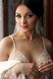 The bride looks romantic in the room.  royalty free stock image
