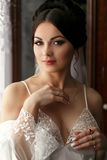The bride looks romantic in the room.  royalty free stock photography