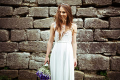 Bride looks stunning being half-hidden behind her hair Royalty Free Stock Images