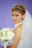 Bride looks at us - portrait Stock Photo