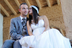 Bride in a loving moment in a warehouse Royalty Free Stock Image