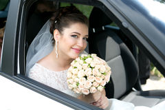 Bride in luxury car royalty free stock images