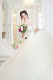 Bride in luxury interior in palace. Wedding, attractive brunette Royalty Free Stock Photography