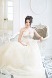 Bride in luxury interior in palace. Wedding, attractive brunette. Bride in luxury interior in palace stock photography