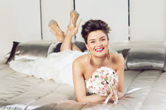 Bride lying on bed Stock Images