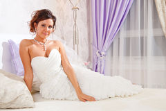 Bride on bed Royalty Free Stock Photo