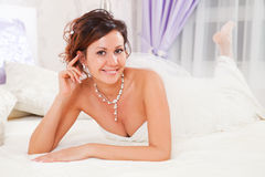 Bride on bed Stock Images