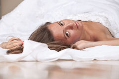 Bride lying on the floor Royalty Free Stock Photos