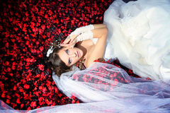 Bride is lying in the flowers Stock Images