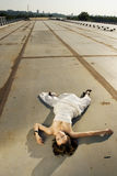 Bride lying on the road royalty free stock photo