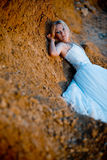 Bride lying on rock Stock Photography