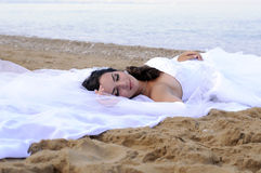 Bride. Lying on the sand at the beach Royalty Free Stock Photo