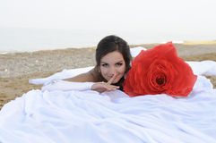 Bride. Lying on the sand at the beach Royalty Free Stock Photos