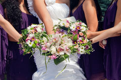 Bride and maids of honor with bouquetes royalty free stock image