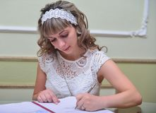 The bride make the signature Royalty Free Stock Photo
