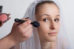 Bride make-up. Bride close-ups and make-up artist make-up royalty free stock image