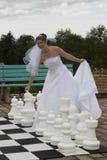 The Bride makes her move. Fun wedding photo of bride Stock Image