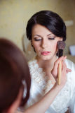 Bride makeup is applied in  morning Stock Photos