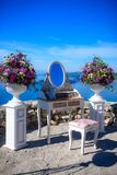 Bride makeup table. With flowers and a mirror in open air Royalty Free Stock Photography