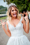 Bride making rock n roll hand sign. And making silly faces Royalty Free Stock Images