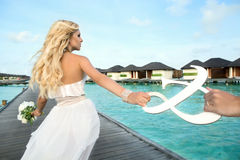 Bride on Maldives. With an ampersand royalty free stock photography
