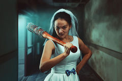 Bride maniac with baseball bat. Bride maniac with bloody baseball bat Royalty Free Stock Images