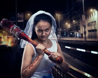 Bride maniac with bloody baseball bat. Night city on background Royalty Free Stock Photos