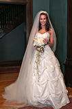 Bride in Mansion Before Wedding 2. Bride in front of staircase with bouquet royalty free stock photos
