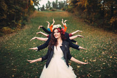 Bride with many hands in a forest. Bride in corolla with many hands in forest smile royalty free stock photos