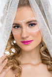Bride with mask drawn on face Royalty Free Stock Image