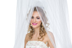 Bride with mask drawn on face Stock Photo