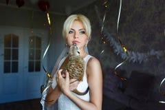 Bride with meerkat Stock Photography