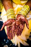 Bride with mehendi. Bride groom hands well decorated with mehendi before wedding. Mehendi applied royalty free stock photography