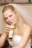 Bride with a milk shake. Bride is drinking milk shake Stock Photo